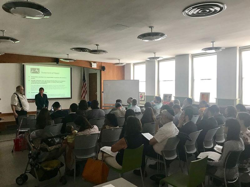 facilitators presenting to classroom of adults